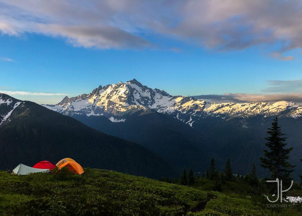Backpacking under the towering ridges of Mount Shuksan